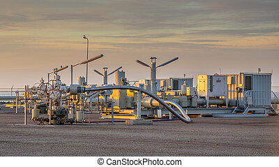 Oil and gas processing plant in the Waddensea area with pipe...