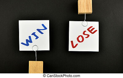 win lose, two paper notes on black background
