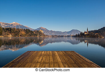A wooden dock, pier, on a lake