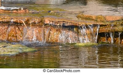 Brook water stream with small rift in day time, selective...