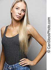 Fashion portrait of a confident and blonde young woman -...