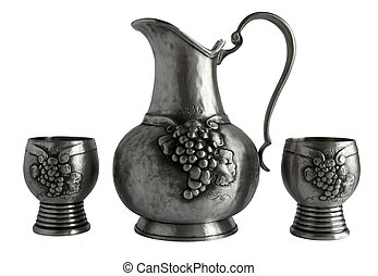 Antique pewter pitcher and goblets isolated on white...