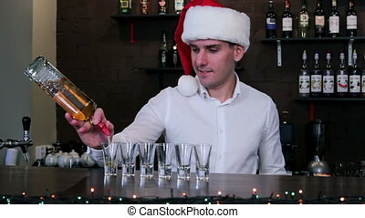 The bartender in the Santa hat - The guy pours the alcohol...
