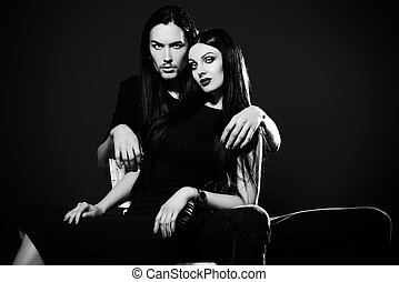 relaxed - Fashion shot of a beautiful sexual couple in black...