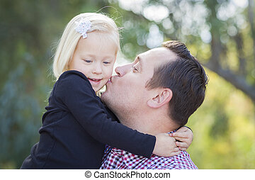 Father Kissing Adorable Little Girl Outdoors