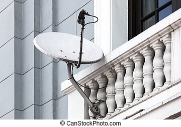 satellite dish on the balcony of the house