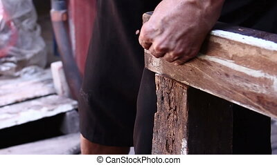 Hammer In Nails Into Wooden - close up Hammer In Nails Into...