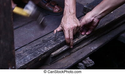 Hammer In Nails Into Wooden