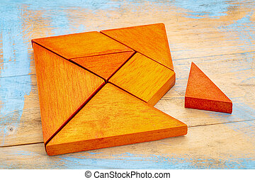 tangram puzzle - a missing piece in a square built from...