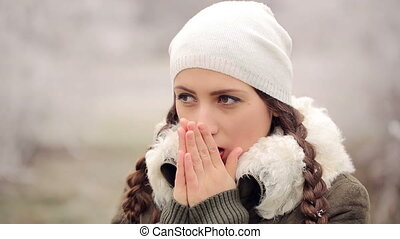 Woman Warms Hands - woman got cold in winter