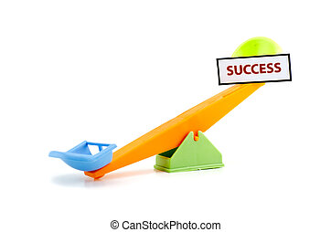 image concept unbalance seesaw with word SUCCESS printed...