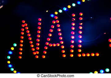 Nail spa neon light sign at night photo