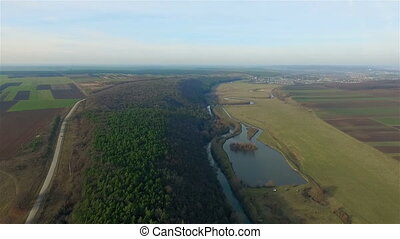 Aerial view over the forest and lake