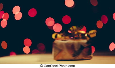 Christmas gift rotate around its axis on bokeh background...