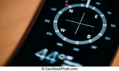 Compass on the phone revolves around its axis Close up video...