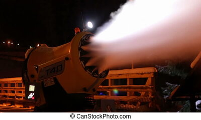 Snow cannons are working at night.