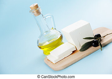 Feta cheese with olive branch and oil
