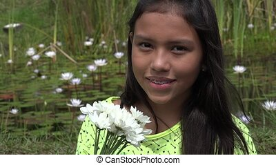 Girl Posing near Lilypad Pond