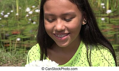Young Girl Laughing near Pond