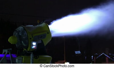 Snow cannons are working at night. - Snow guns producing...
