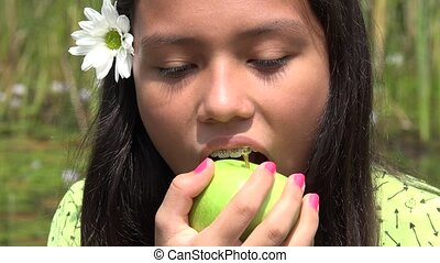 Female Child Eating an Apple