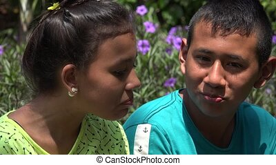 Boy and Girl Talking Outdoors
