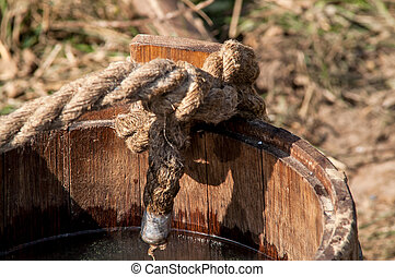 wooden bucket with a mop - medieval historic wooden bucket...