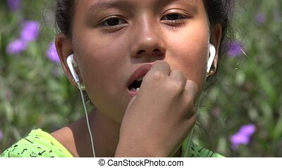 Girl With Braces Eating Candy
