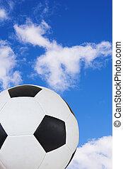 flying soccer ball - Black and White soccer ball against a...