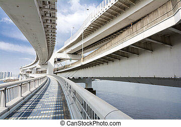 View from overhead walkway of flyovers above the sea in...