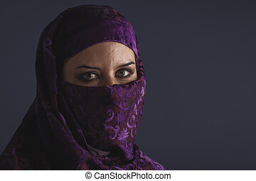muslim, Beautiful arabic woman with traditional burqa veil