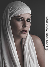 wellness beautiful woman with a white towel on her head,...