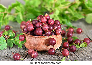 Red gooseberries on country table - Red gooseberries in...