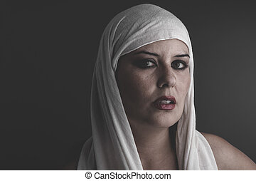 beautiful woman with a white towel on her head, sauna and...