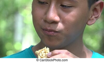 Teen Boy Eating Granola Snack