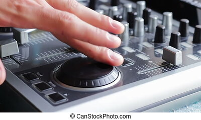 DJ Working with Sound mixing console. - DJ working with an...