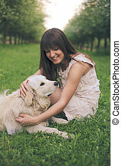 Girl plays with dog