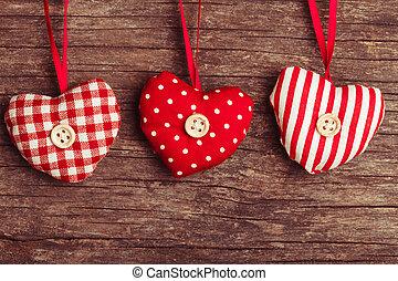 sewed christmas decor - White and red sewed christmas hearts...