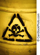 Toxic waste symbol on a yellow barrel.