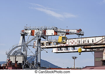 big crane in the harbour of genova - big crane for scrap...