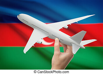 Airplane in hand with flag on background - Azerbaijan -...
