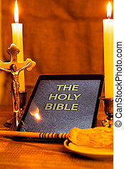Digital holy bible on tablet computer in the scenery of the...
