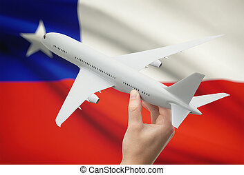 Airplane in hand with flag on background - Chile - Airplane...