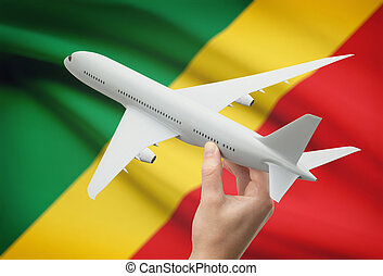 Airplane in hand with flag on background - Congo-Brazzaville...