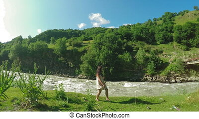 Girl on shore mountain river - Mountain river and Sitting on...