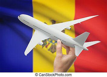 Airplane in hand with flag on background - Moldova -...