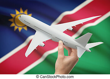 Airplane in hand with flag on background - Namibia -...