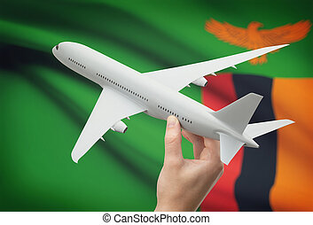Airplane in hand with flag on background - Zambia - Airplane...