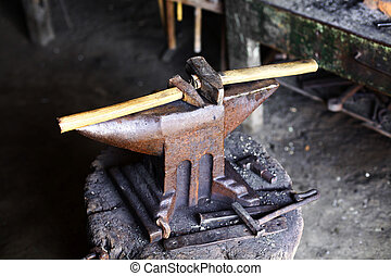 Anvil and hammer - Color shot with a hammer and an anvil.