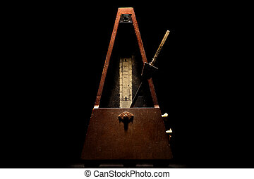 Vintage metronome - Vertical shot of a vintage metronome, on...